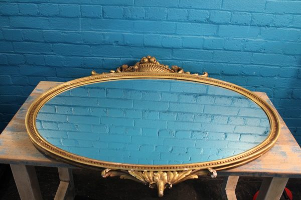 Large oval gilt wall mirror