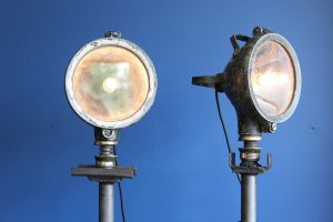 Pair of Ferret lamps on axle stands