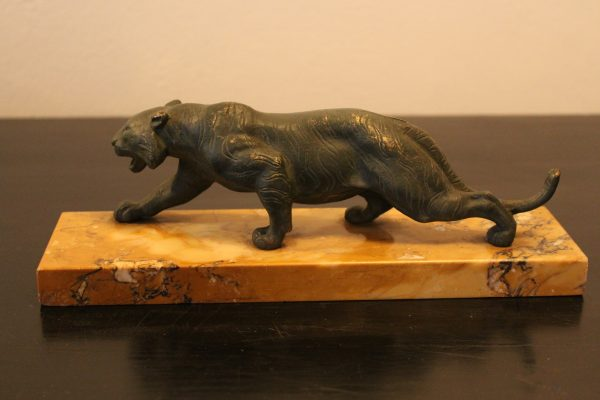 Bronze tiger on marble